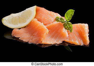 Salmon background. - Salmon with lemon and basil isolated on...