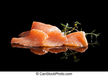 Salmon isolated on black. - Smoked salmon pieces isolated on...
