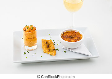 Creme Brulee, glass of wine, white background, studio shot.