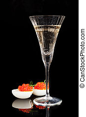 Champagne and caviar. - Caviar in egg with dill and...