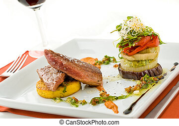 Gourmet meat dish. - Gourmet dish of meat and vegetables,...