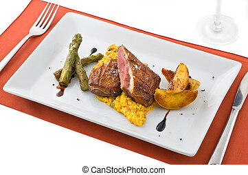 Gourmet dish with meat.