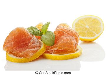 Smoked salmon with lemon. - Salmon with lemon slices and...