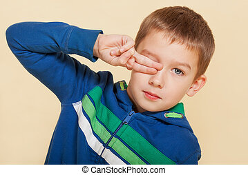 Young boy covering his eye - Young cute boy ten years old...