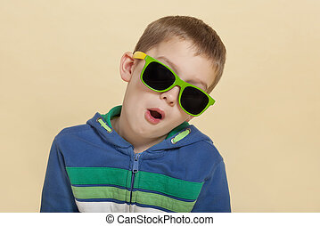 Surprised boy with sunglasses isolated. - Funky cool young...