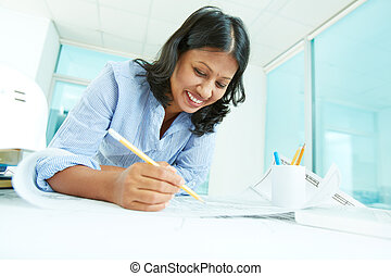 Planning work - Portrait of mature businesswoman working...
