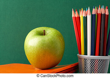 Vitamins for art - Close-up of big green apple on stack of...