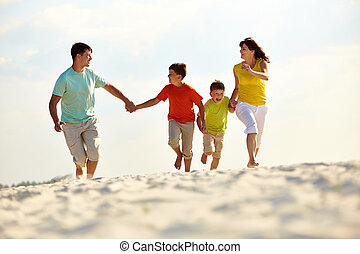 Carefree family - Photo of happy family running down the...