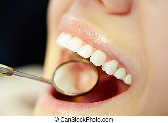 Mouth care - Close-up of open mouth during oral checkup at...