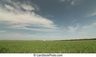 Child Running on Spring Field
