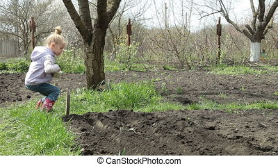 Smallholder Farm - Little Girl Planting Peas on Smallholder...