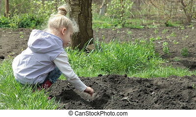 Planting Peas on Smallholder Farm - Little Girl Planting...