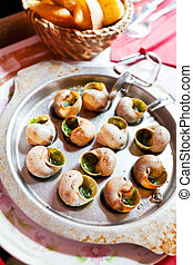Escargots - hot plate of escargot shells, with special tongs...