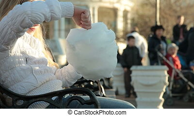 girl eating cotton candy - Urban scene - little girl eating...