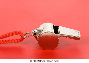 Whistle - a whistle with red background