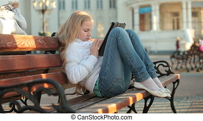Child Using Touch Screen Tablet PC - Urban Scene - Child...