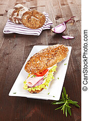 Wholegrain baguette. - Wholegrain baguette with ham and...