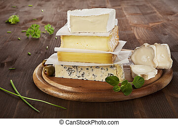 Cheese variation. - Luxurious cheese variation on wooden...
