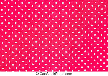 White polka dots on red fabric.