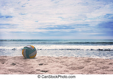 Summer beach with turquoise ocean. - Volleyball ball on...