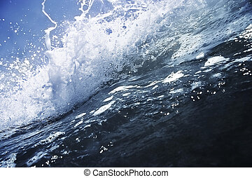 Wave breaking. - Big deep blue wave breaking with white...