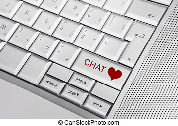 Internet love. - Silver keyboard with heart icon and CHAT...