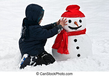 snowman - boy with snowman on winter park