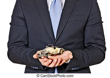 car insurance and protection - old car in the hands of a man