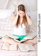 frightened girl reading a book on bed - frightened girl...