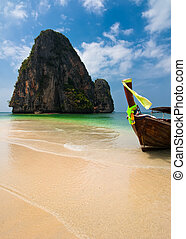 Tropical beach landscape. Thai traditional long tail boat