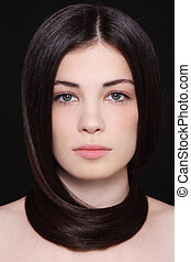 Hair care - Portrait of young beautiful woman with dark hair