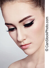 Eyeliner - Close-up portrait of young beautiful girl with...