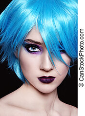 Cosplay - Portrait of young beautiful girl in fancy blue wig