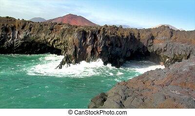 los hervideros vulcan lava cave wave