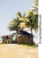 thatch roof bamboo architecture beach restaurant bar Big Corn Island Nicaragua Caribbean Sea Central America with coconut palm trees