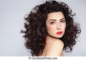 Curly hair - Young beautiful woman with gorgeous long curly...