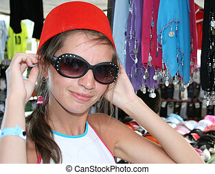 Young woman trying on the traditional hat worn in Turkey -...