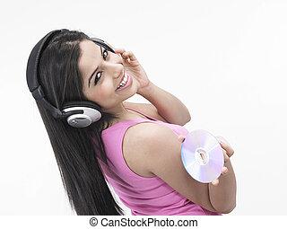 techno-savvy girl enjoying music - asian girl enjoying music...