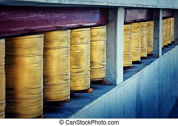 spool - gold tibetan spool in himalayas