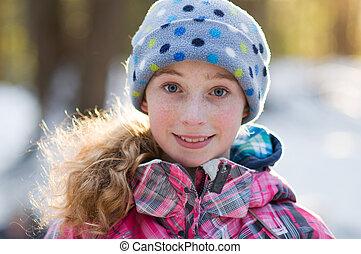 beautiful teen girl wearing winter clothing outdoors
