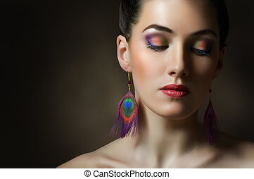 colorful makeup - a beauty girl on the dark background