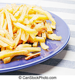 French fries potatoes on plate