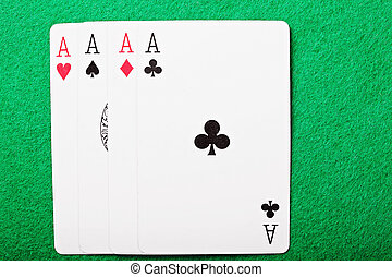 Four aces above view - Four aces on green cloth above view