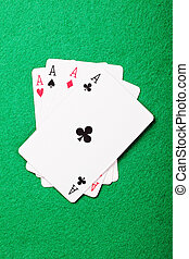 Aces cards above view - Aces cards on green cloth above view