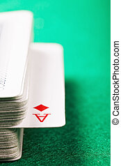 Ace of diamonds in card deck closeup photo selective focus