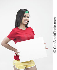 smiling woman with a blank placard