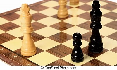 Chess game board composition with two bishop and a pawn....