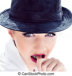 Coseup portrait of a beautiful elegant young woman with black hat
