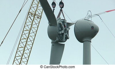 montage of wind rotor with crane close up