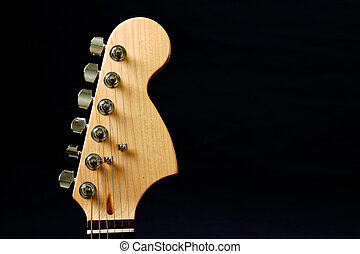 Guitar headstock against dark background